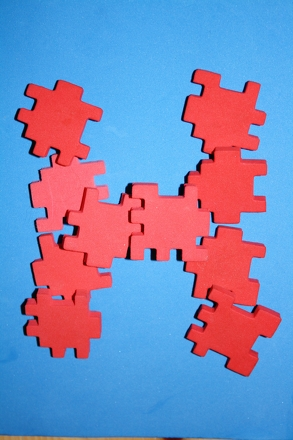 Kindergarten Arts & Crafts Activities: Play a Puzzle Piece Spelling Game