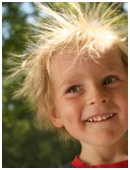 When you rub a balloon on your head, your hair stands up; but is that true for everyone? Does hair color affect static electricity?