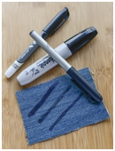 Test out various brands of permanent markers to see which one is least water soluble.