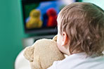 Find out why the TV show in the background is harming your child's learning.