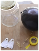 Kids will make a homemade electroscope and explain how it detects static charges through induction in this fun science fair project idea.