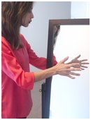 This project examines the phenomenon of using a mirror to trick a person's brain into experiencing sensations in body parts not actually affected.