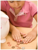 Have a jar full of coins just waiting to be dumped into Coinstar? Why not use those coins to teach your child about math and money?