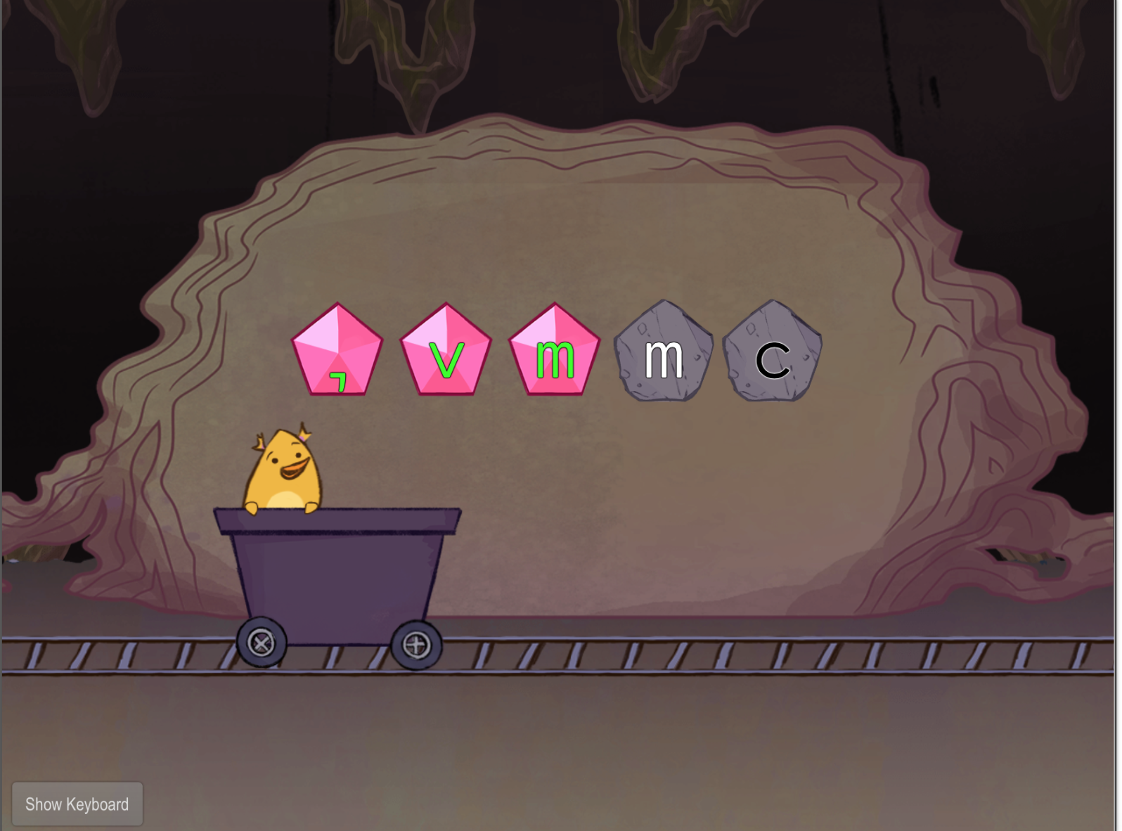 1st grade Typing Games: Bottom Row Typing: V-M-C-Comma with Gem Miner