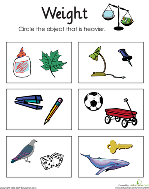 First Grade Math Worksheets: Heavy or Light: Measuring Weight